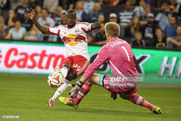 New York Red Bulls forward Bradley WrightPhillips avoids Sporting KC goalkeeper Eric Kronberg to score his first goal of the match between the New...