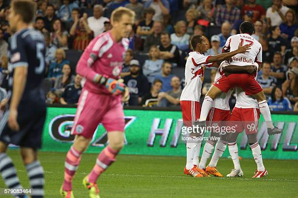 Red Bull teammates celebrate after New York Red Bulls forward Bradley Wright-Phillips scores his first goal of the match between the New York Red...