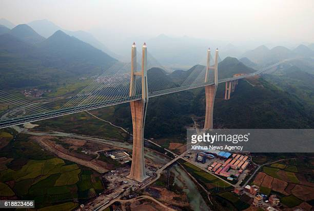 CHENZHOU Oct 27 2016 Aerial photo taken on Oct 27 2016 shows the Chishi Bridge in Chishi Village in Yizhang County of Chenzhou City central China's...