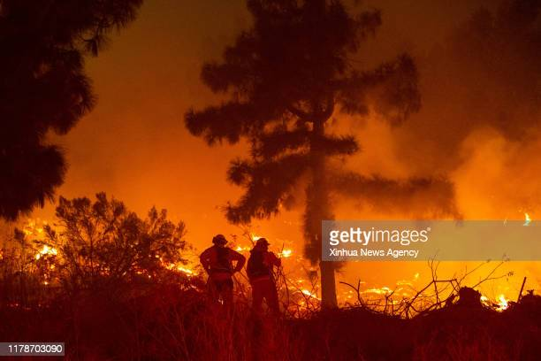 LOS ANGELES Oct 28 2019 Firefighters work near Getty Center in Los Angeles the United States Oct 28 2019 Thousands of residents were forced to...