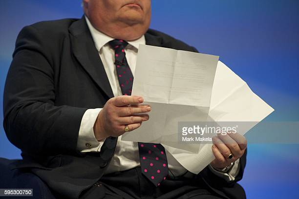Oct 3 2011 Manchester England UK Secretary of State for Communities and Local Government ERIC PICKLES looks over his notes while taking part in a...