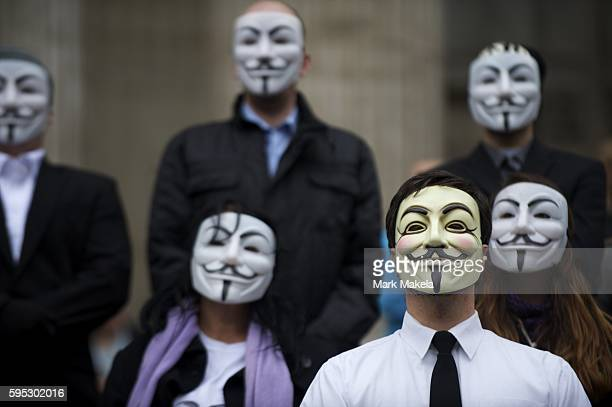 Oct 30 2011 London England UK 'Occupy London' protestors wearing Guy Fawkes masks listen to the Bishop of London Richard Chartres and Dean of St...