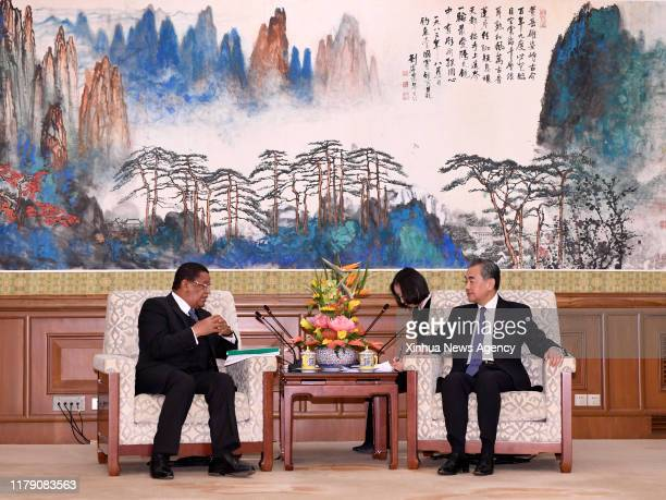 Oct. 30, 2019 -- Chinese State Councilor and Foreign Minister Wang Yi R meets with former Ethiopian President Mulatu Teshome, who visits China as...