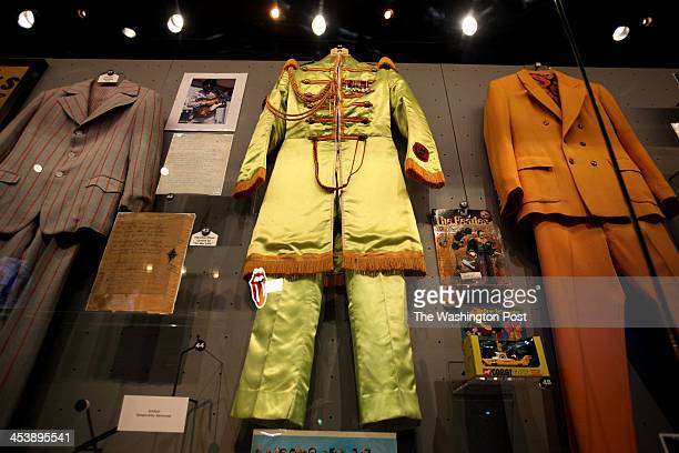 Under glass hangs the suit that John Lennon wore for the Sgt Pepper's Lonely Hearts Club album cover in 1967 inside the Beatles exhibit at the Rock...