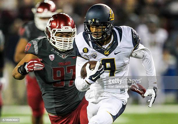 California Golden Bears wide receiver Trevor Davis runs pass Washington State Cougars defensive lineman Destiny Vaeao on a touchdown reception during...