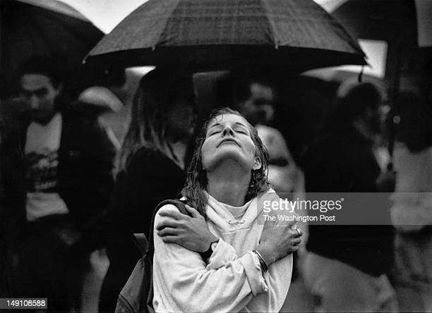 Oct 9 1992 Washington Post photo by Carol Guzy Location Washington Monument grounds AIDS Quilt unfolding postponed due to rain CAPTION Anna...
