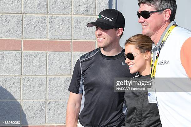 Jordan Fish poses for a photo with boyfriend Denny Hamlin before the start of the Better Half Dash at the Charlotte Motor Speedway in Concord NC...