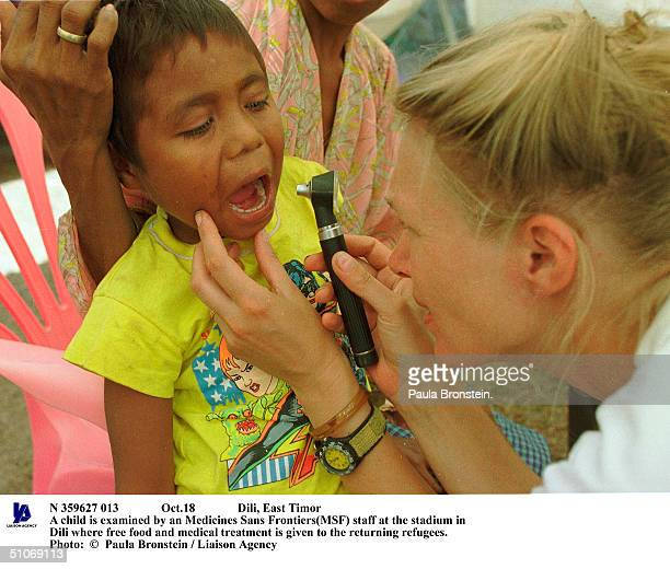 Oct18 Dili East Timor A Child Is Examined By An Medicines Sans Frontiers Staff At The Stadium In Dili Where Free Food And Medical Treatment Is Given...
