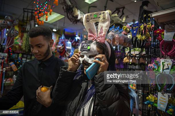 Viktoria Dortch trys on masks and bunny ears with Kennard Brown October 2014 at Total Fright in Ballston Common Mall in Arlington VA Photo by Evelyn...