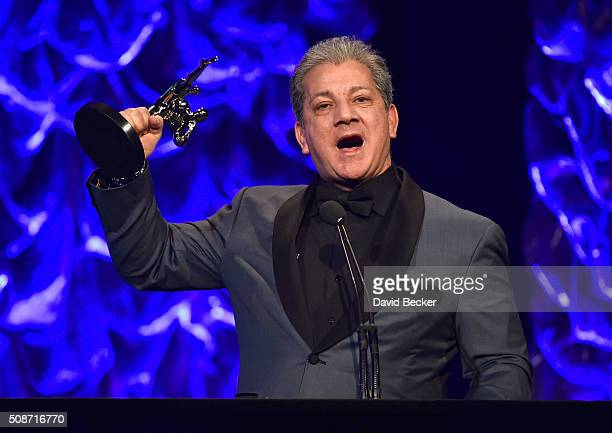 Octagon announcer Bruce Buffer accepts the Lifetime Achievement award at the eighth annual Fighters Only World Mixed Martial Arts Awards at The...