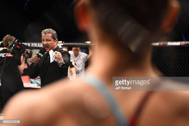 Octagon announcer Bruce Buffer introduces Alexandra Albu of Russia before her women's strawweight fight against Izabela Badurek of Poland during the...