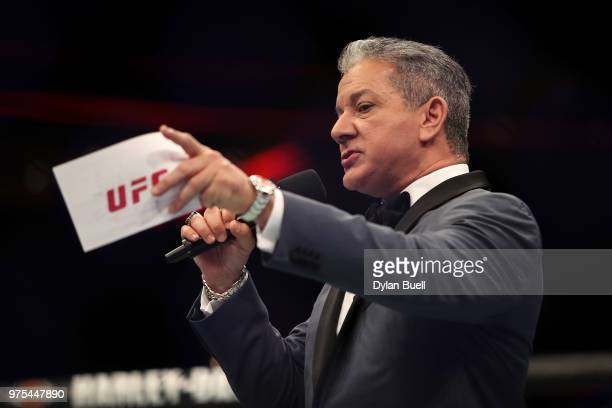 Octagon announcer Bruce Buffer introduces Dan Ige and Mike Santiago before their featherweight bout during the UFC 225 Whittaker v Romero 2 event at...