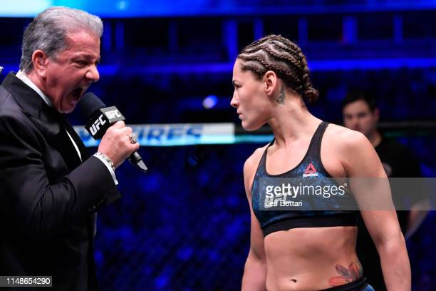 Octagon announcer Bruce Buffer introduces Jessica Eye prior to her women's flyweight championship bout against Valentina Shevchenko of Kyrgyzstan...