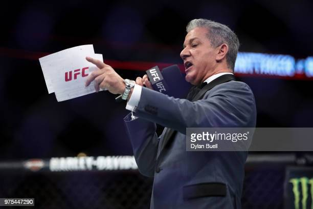 Octagon announcer Bruce Buffer introduces Robert Whittaker of New Zealand and Yoel Romero of Cuba before their middleweight title fight during the...