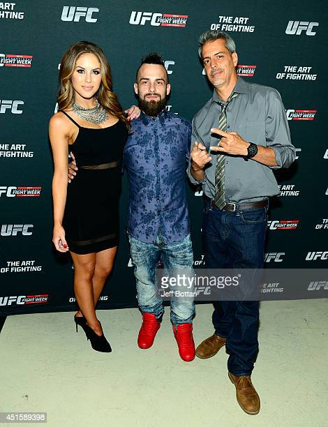 UFC Octagon Girl and artist Brittney Palmer artist Brian Kirhagis and artist Justin Bua arrive at the Art of Fighting Exhibition to kick off the UFC...
