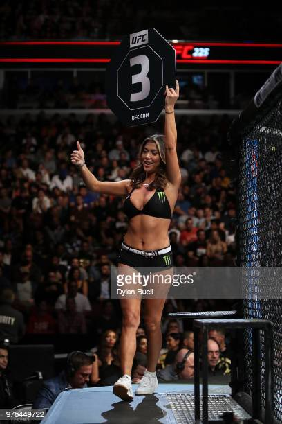 Octagon Girl Arianny Celeste signals the start of the third round of the heavyweight bout between Andrei Arlovski of Belarus and Tai Tuivasa of...