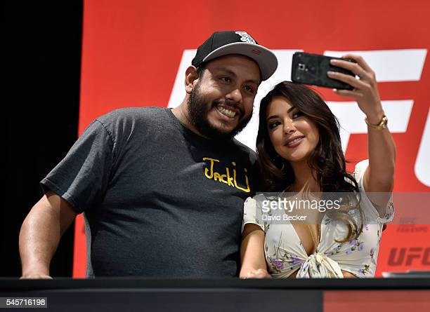 Octagon Girl Arianny Celeste takes a selfie with a fan during the UFC Fan Expo at the Las Vegas Convention Center on July 9 2016 in Las Vegas Nevada