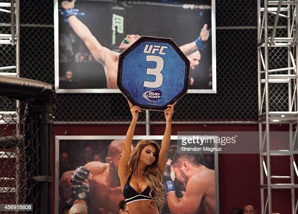 Octagon Girl Betzy Montero signals the third round between Team Velasquez fighter Marco Beltran and team Werdum fighter Guido Cannetti in their...