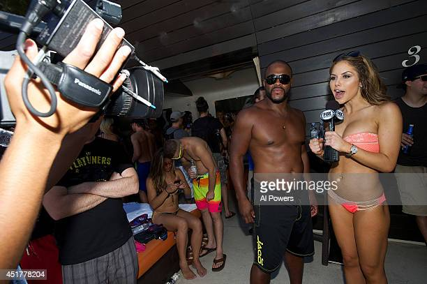 Octagon Girl Brittney Palmer interviews Rashad Evans at the UFC pool party during UFC International Fight Week at the Liquid Pool Lounge at the Aria...