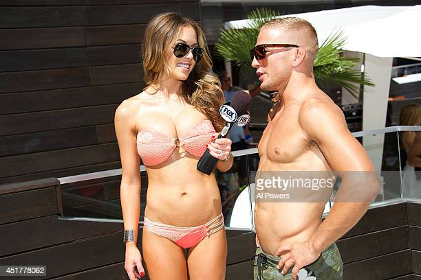 Octagon Girl Brittney Palmer interviews UFC bantamweight champion TJ Dillashaw at the UFC pool party during UFC International Fight Week at the...