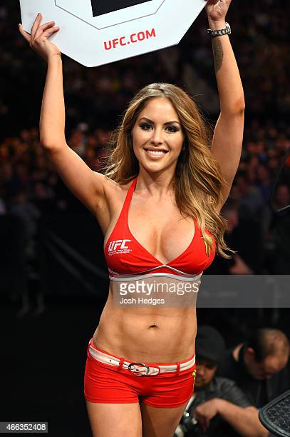 Octagon Girl Brittney Palmer walks the perimeter of the Octagon during the UFC 185 event at the American Airlines Center on March 14 2015 in Dallas...