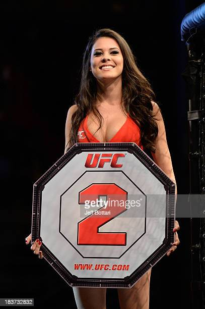 Octagon Girl Camila Rodrigues de Oliveira walks the Octagon between rounds during the Iliarde Santos and Chris Cariaso fight in their flyweight bout...