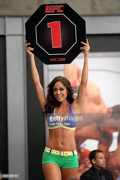 Octagon Girl candidate Ana Cecilia signals the start of round one between Team Wanderlei fighter Ricardo Abreu and Team Sonnen fighter Guilherme de...