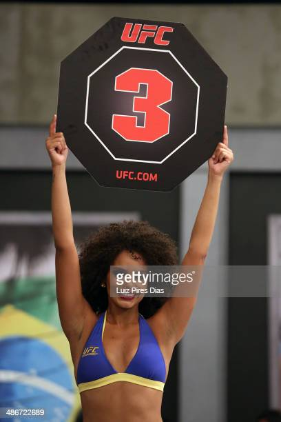 Octagon Girl candidate Thais Andrade signals the start of round three between Team Wanderlei fighter Richardson Moreira and Team Sonnen fighter Job...