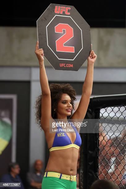 Octagon Girl candidate Thais Andrade signals the start of round two between Team Wanderlei fighter Richardson Moreira and Team Sonnen fighter Job...