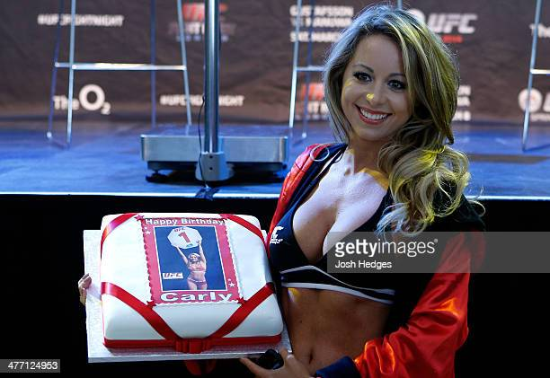 Octagon Girl Carly Baker is presented with a cake on her birthday during the UFC weighin event at the O2 Arena on March 7 2014 in London England