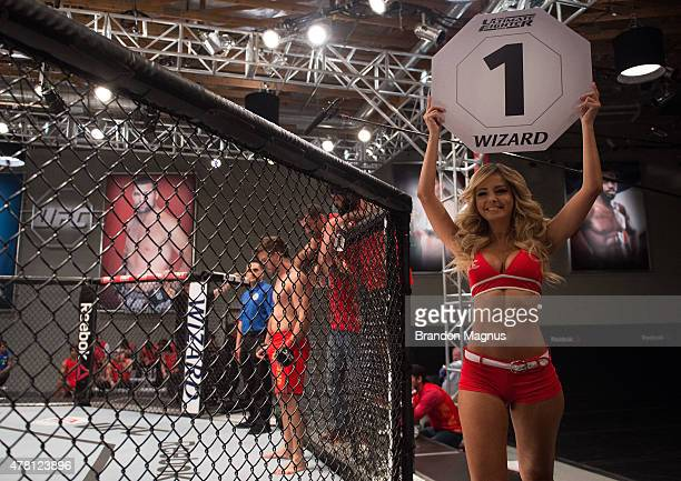Octagon Girl Jhenny Andrade introduces the first round during the semifinals for filming of The Ultimate Fighter Brazil Team Nogueira vs Team Rua on...