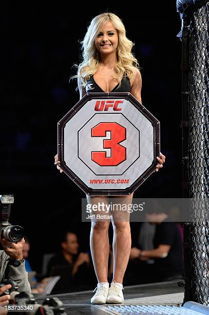 Octagon Girl Jhenny Andrade walks the Octagon between round during the welterweight bout between Yan Cabral and David Mitchell during the UFC Fight...
