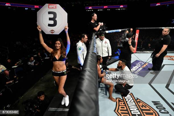 Octagon Girl Vanessa Hansen signals the start of round three between Viviane Pereira of Brazil and Tatiana Suarez in their women's strawweight bout...