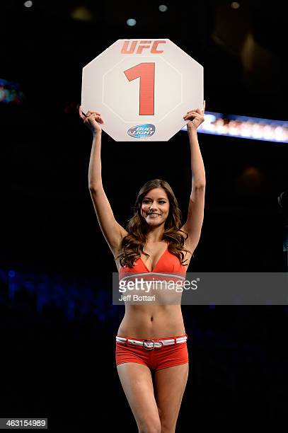 Octagon Girl Vanessa Hanson signals the start of round one before the welterweight fight between Beneil Darisuh and Charlie Brenneman during the UFC...