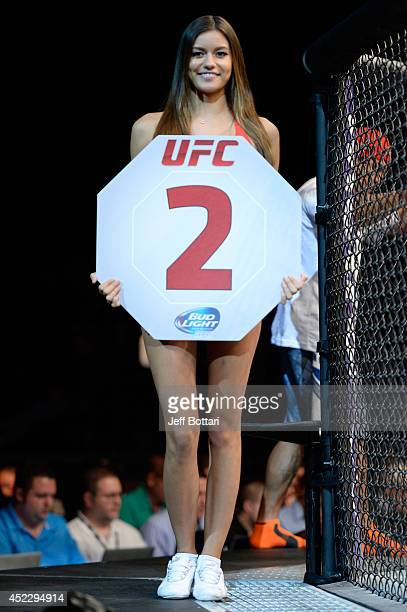 Octagon Girl Vanessa Hanson signals the start of round two between Lucas Martins and Alex White in their featherweight bout during the UFC Fight...