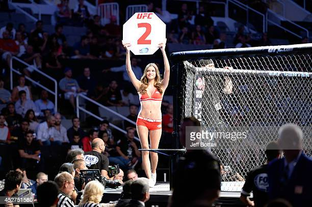Octagon Girl Vanessa Hanson signals the start of round two between Kyle Kingsbury and Patrick Cummins in their light heavyweight bout during the UFC...