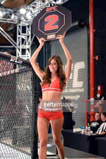 Octagon Girl Vanessa Hanson signals the start of round two between Team Edgar fighter Todd Monaghan and Team Penn fighter Daniel Spohn in their...