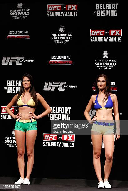 UFC Octagon Girls Camila Rodrigues de Oliveira and Aline Caroline Franzoi stand on stage during the UFC on FX official weighin event on January 18...