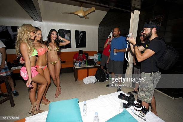 UFC Octagon Girls Jhenny Andrade Brittney Palmer and Camila Oliveira pose for fans at the UFC pool party during UFC International Fight Week at the...