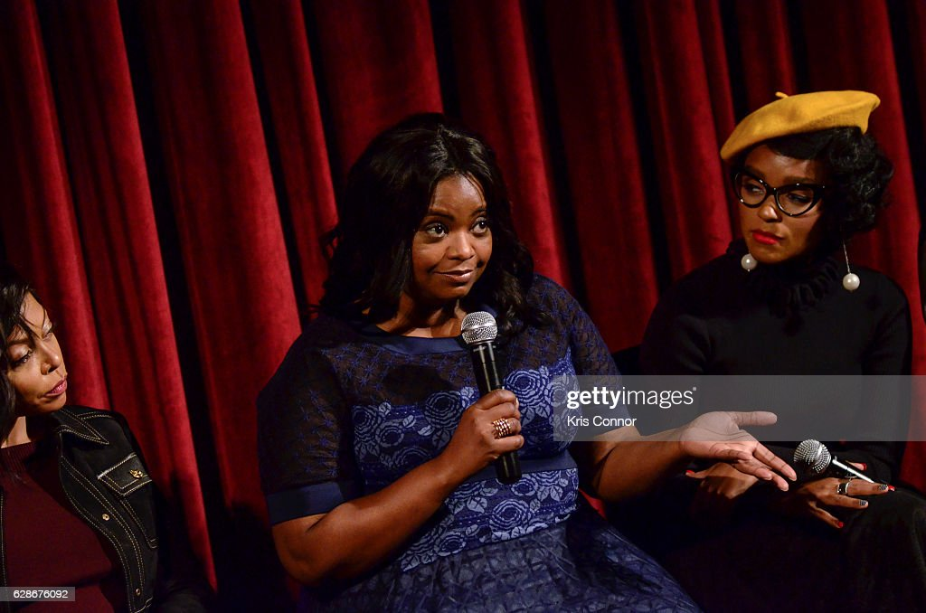 Octavia Spencer and Janelle Monae speak during an official academy screening of HIDDEN FIGURES hosted by the The Academy of Motion Picture Arts and Sciences at MOMA - Celeste Bartos Theater on December 8, 2016 in New York City.