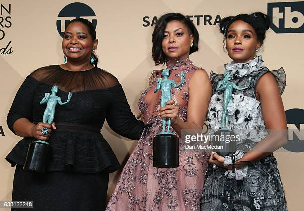 Octavia Spencer Taraji P Henson and Janelle Monae pose in the press room with their award for Outstanding Performance by a Cast in a Motion Picture...