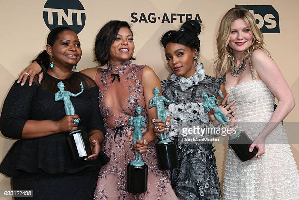 Octavia Spencer Taraji P Henson Janelle Monae and Kirsten Dunst pose in the press room with their award for Outstanding Performance by a Cast in a...