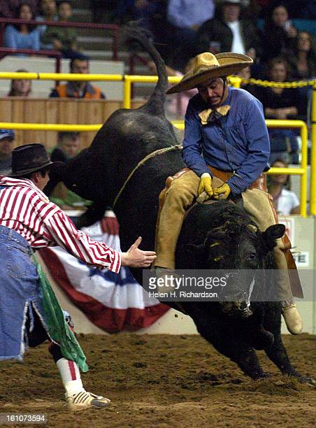 Octavio Hermosillo <cq> of Nicolas Bravo Chihuahua <cq> tries to hang on to a bull during the BullRiding Charrostyle The Mexican Rodeo Extravaganza...