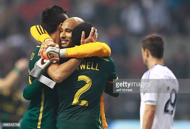 Octavio Rivero of the Vancouver Whitecaps FC looks on dejected as Adam Kwarasey of the Portland Timbers is congratulated by teammates Norberto...