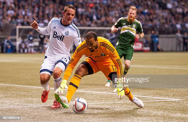 Octavio Rivero of the Vancouver Whitecaps FC tries to get to the loose ball ahead of goalkeeper Adam Kwarasey of the Portland Timbers in MLS action...