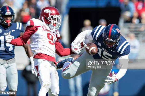 Octavious Cooley of the Ole Miss Rebels has the ball stripped from him by Santos Ramirez of the Arkansas Razorbacks at Hemingway Stadium on October...