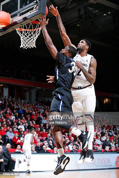 Octavius Ellis of the Cincinnati Bearcats blocks a shot by Kelan Martin of the Butler Bulldogs in the first half of the game at Fifth Third Arena on...