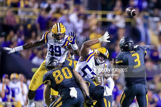 Missouri Tigers quarterback Drew Lock passes over LSU Tigers defensive tackle Davon Godchaux and defensive end Arden Key during the game between the...