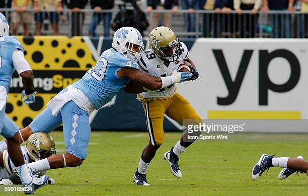 Clinton Lynch is tackled by Jessie Rogers during the NCAA football game between the UNC Tar Heels and the Georgia Tech Yellow Jackets at Bobby Dodd...