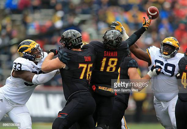 Michigan Wolverines defensive end Taco Charlton crashes into Maryland Terrapins quarterback Daxx Garman during a Big 10 football game at Capital One...